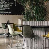 Green and yellow Eames chairs fill Tacofino Ocho restaurant in Vancouver