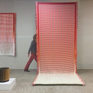 Orange or Red weaves giant tapestries for multifunctional rooms