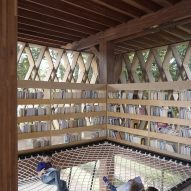 Microlibrary Warak Kayu by Shau hammock-style net floor