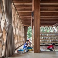 Microlibrary Warak Kayu features a hammock-style floor and a swing