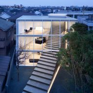 Steel and concrete steps cut through facade of Stairway House by Nendo