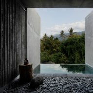 Rough concrete walls frame jungle views at The Tiing hotel in Bali