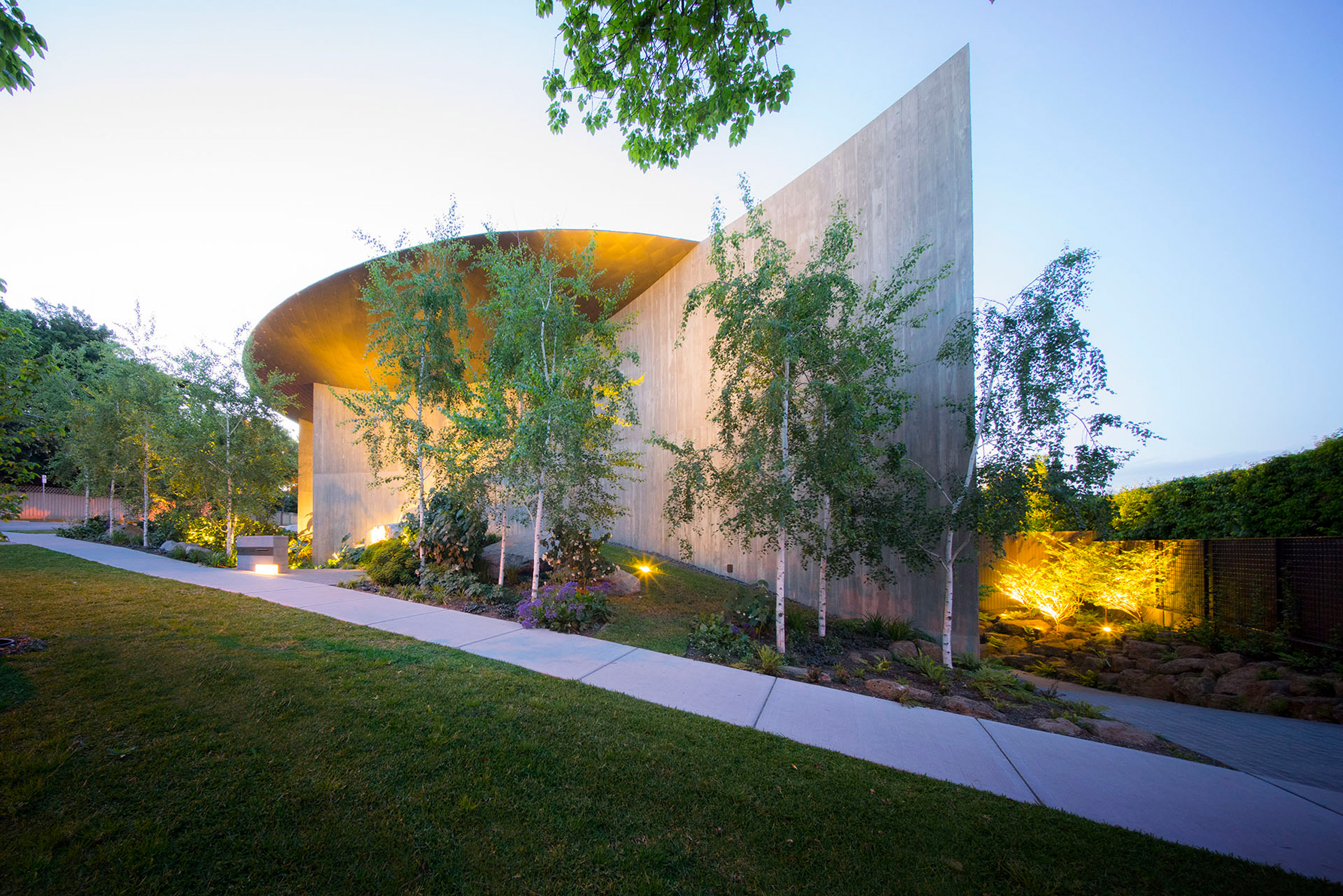 Wood Marsh tops curving concrete walls with zinc disc for