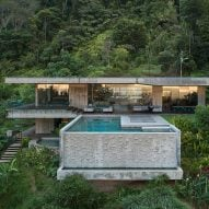 Concrete swimming pool protrudes from Art Villa holiday home in Costa Rican jungle