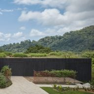 Green roof and charred wood blend Atelier Villa into Costa Rican jungle