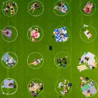 White circles promote social distancing on Domino Park grass in New York City
