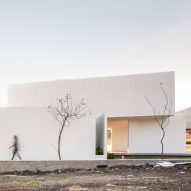 Splayed and stacked white volumes form San Antonio House in Mexico
