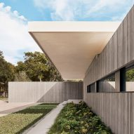 Three cast-concrete volumes form Preston Hollow house by Specht Architects