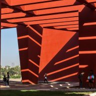 Towering red beams shade walkways of Rajasthan School in India