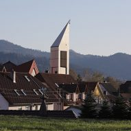 Architektur3 adds triangular timber tower to Black Forest church