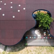 Undulating roof shades Bó Mon preschool by Kientruc O in rural Vietnam