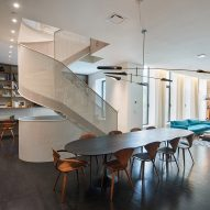 WORKac adds curving perforated steel staircase to Brooklyn apartment