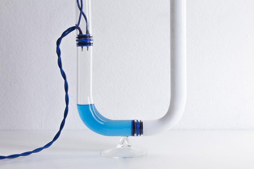 Tubular Circuiti Liquidi lamp uses blue liquid to activate light
