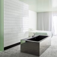Atelier Dialect places mirrored tub in minty green bathroom of Apartment A