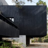 Charred wood and stone create dark house Casa Di-Dox by Magaldi Studio
