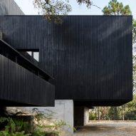 Charred wood and stone create dark house Casa Di-Dox by Magaldi Studio