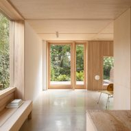 Grove Park house by O'Sullivan Skoufoglou Architects has wooden lining and verdant views