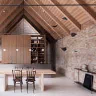 Martin Skoček contrasts contemporary facade of House V with rustic brick interiors