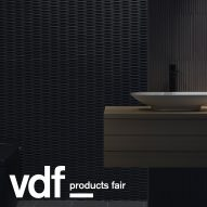 Decorative tiles and freestanding bathtub feature in INAX showcase at VDF products fair