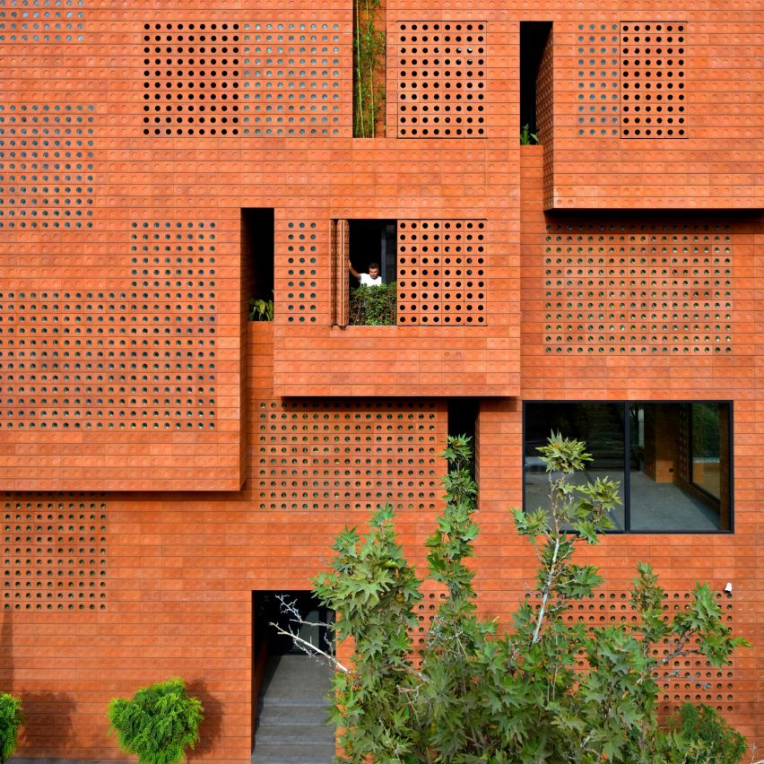 Hooba Design Group wraps Tehran office in glass-punctuated bricks