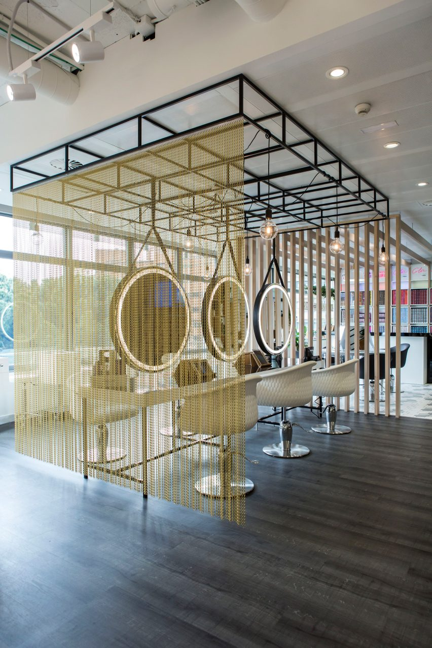 Kriskadecor's chain-link partitions aid social distancing in shared interiors