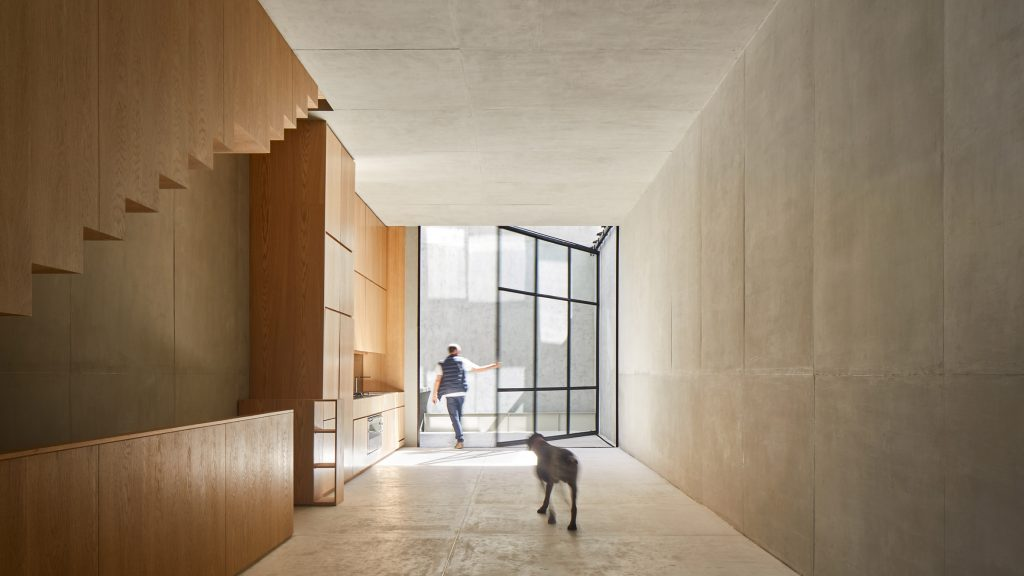 Huge window opens to patios in matching Mexico City houses by PPAA