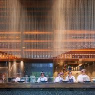 Bronze chainmail curtains add drama to Qualia restaurant in Mumbai