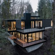 Black wood and glass volumes stagger down Oregon woodland to form Royal house