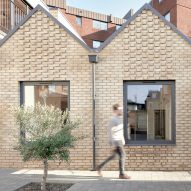 KennedyTwaddle inserts pitched-roofed houses with private courtyards into former timber yard