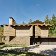 Pulleys open wood shutters covering Wyoming house by Olson Kundig