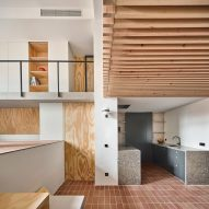 Mas-aqui uses multiple levels to open up Yurikago House in Barcelona