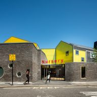 Grey brick and yellow polycarbonate contrast to create striking Peckham primary school