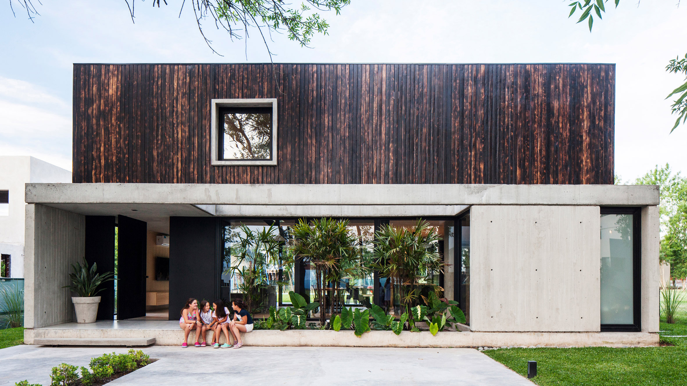 Black House By V2 Arquitectos Contrasts Charred Wood With Concrete
