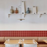 Burnt-red tiles and hessian feature inside Dough Pizza restaurant in Perth