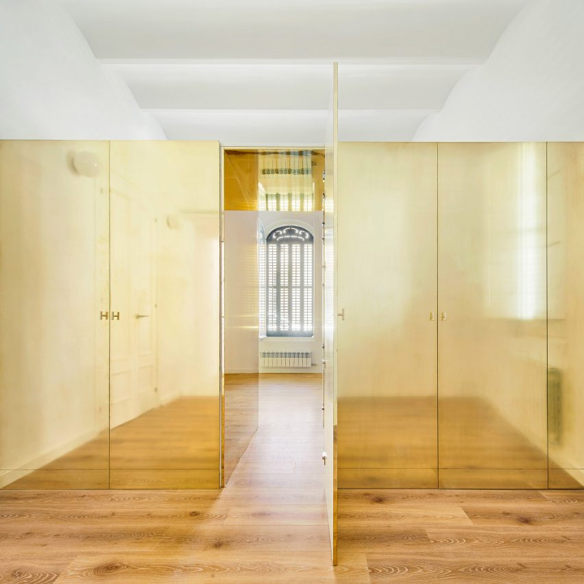 The Magic Box Apartment by Raúl Sánchez Architects features gold wardrobe
