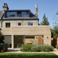 Neil Dusheiko Architects contrasts pale-brick extension with charred-wood garden sauna