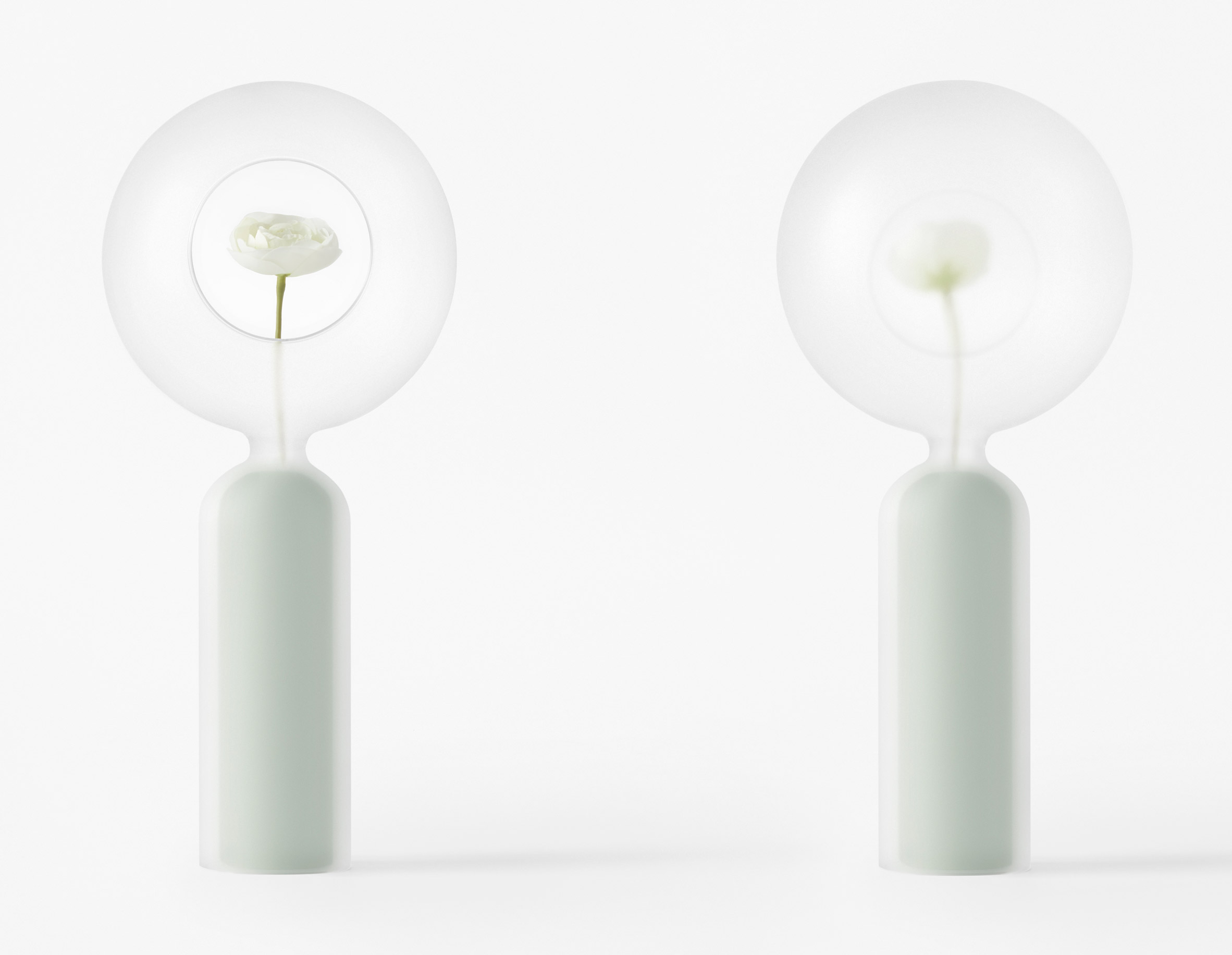 Nendo designs space helmet-shaped vessels and cascading tables for Zens