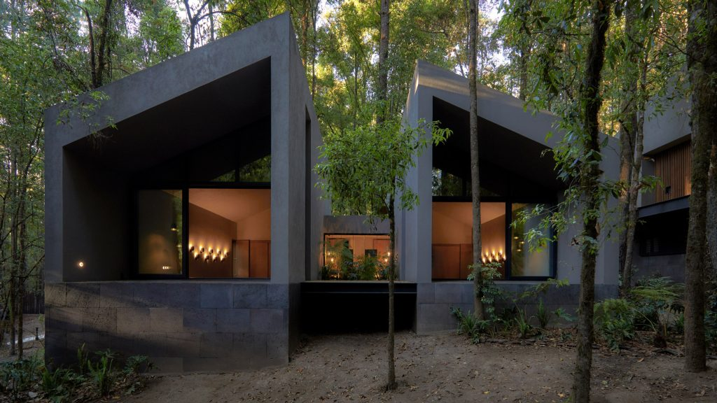 Weber Arquitectos builds San Simon Cabins from volcanic rock