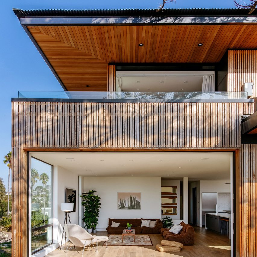 Overhanging roofs shade outdoor areas of cedar-clad Seaside Reef House