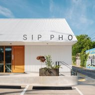 Corrugated white metal clads Vietnamese restaurant in Austin