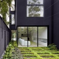 Winter Architecture contrasts black facade of Melbourne townhouse with minimal white interiors