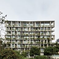 Concrete balconies and planters front Lima apartments by Barclay & Crousse