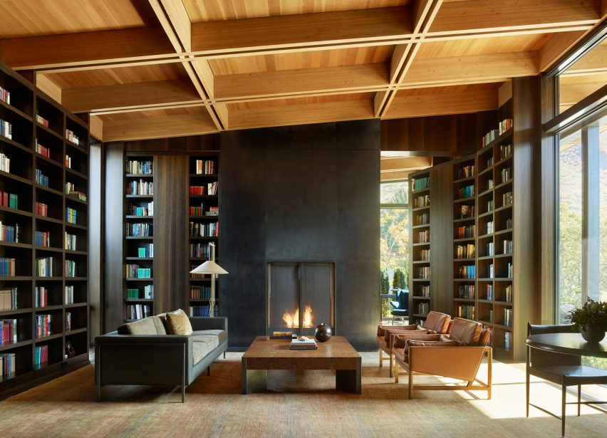 Library room with statement fireplace
