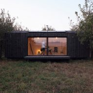 A6A constructs charred-wood off-grid cabin in Ustaritz