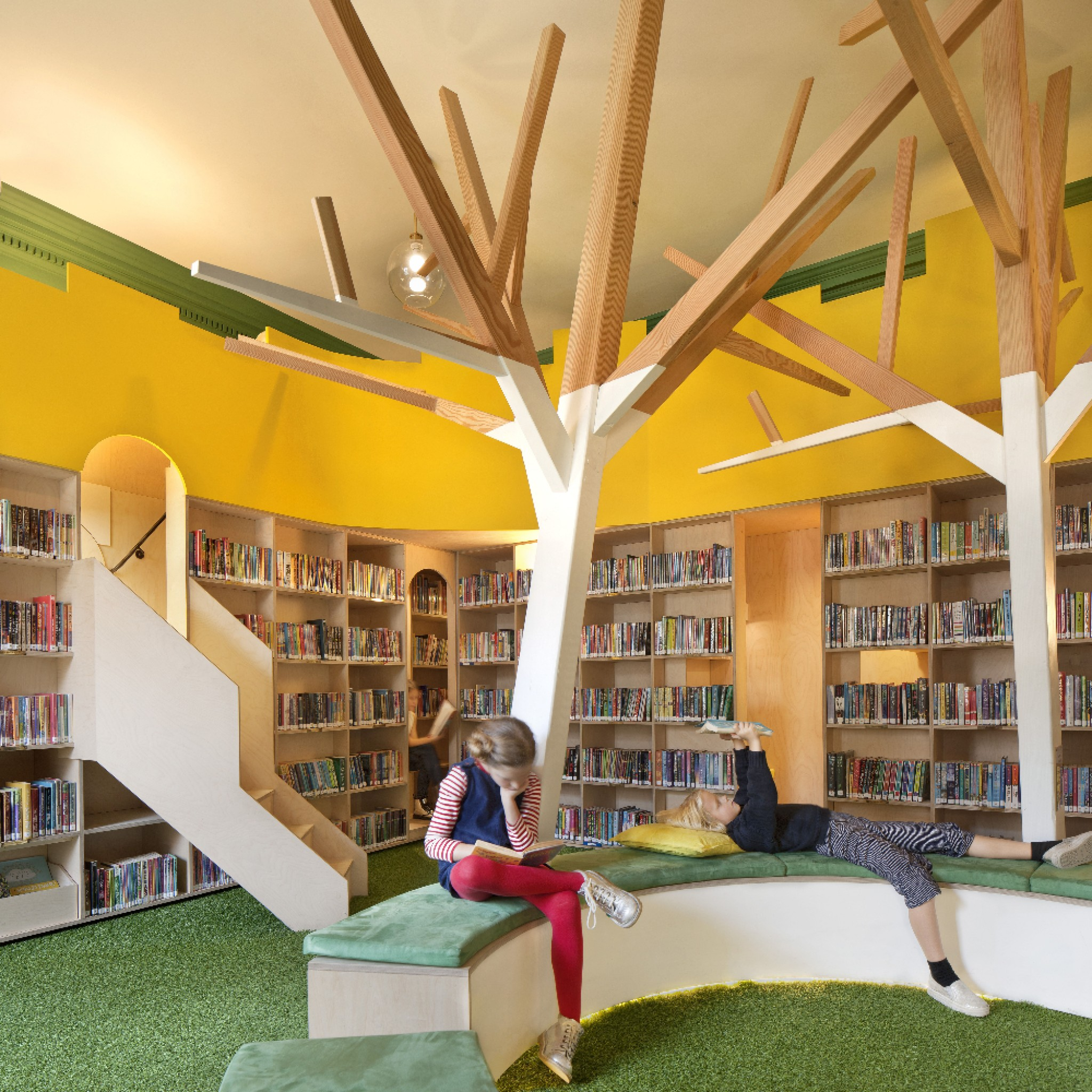John Ramplin Room - full-height plywood walls of shelves evoke the grand libraries of the past, with a markedly playful and modern twist