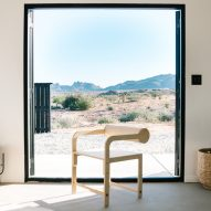 White stucco Casa Mami by Working Holiday Studio contrasts California desert landscape