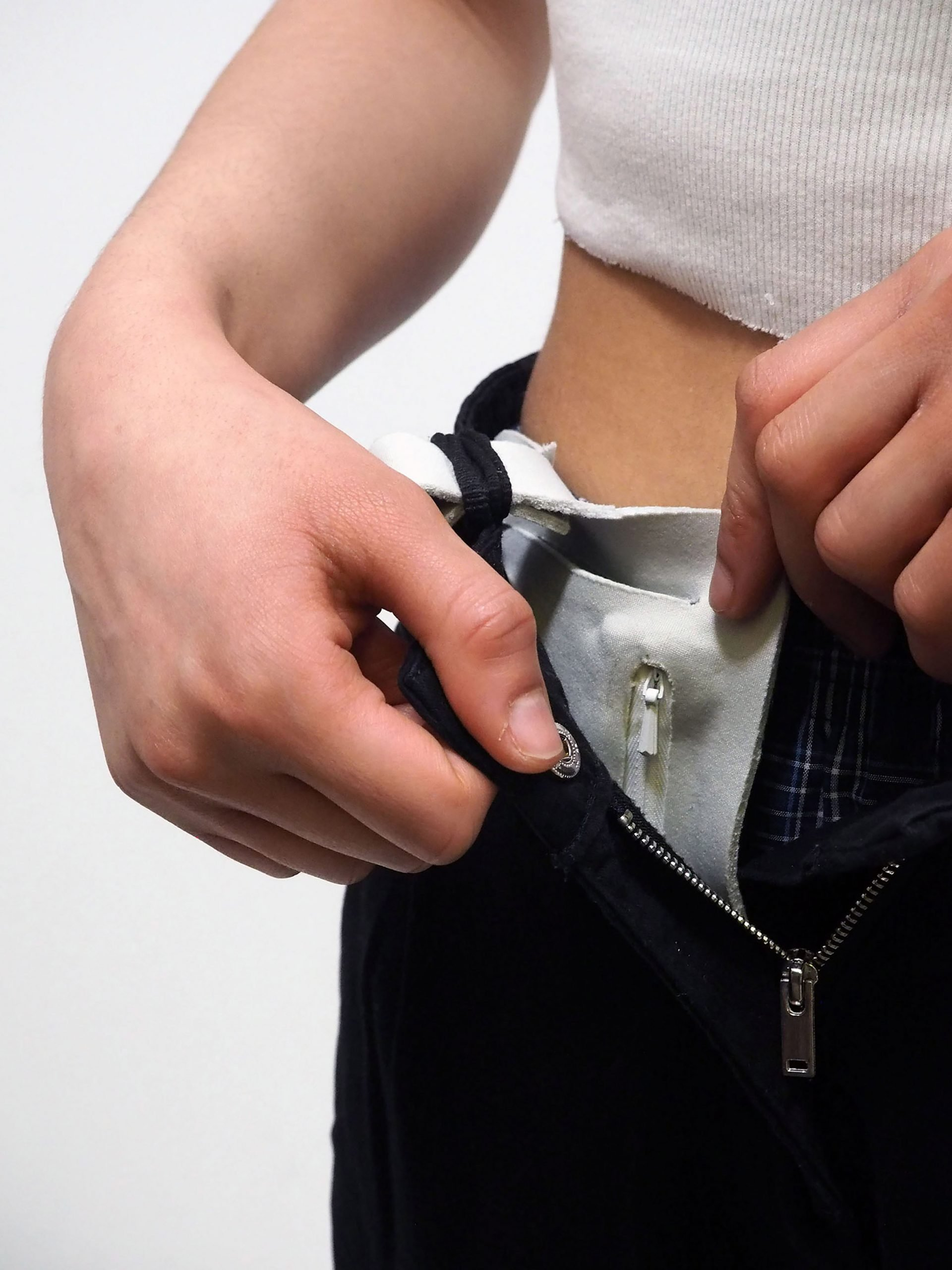 "Carrie is a ""wearable pocket"" for police and army to store period products"
