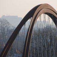 Useful Studio creates arched weathering steel Chiswick Park Footbridge