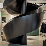 Black spiral staircase twists through Joseph store in Miami Design District