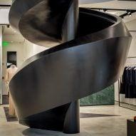Black staircase twists up Joseph store in Miami Design District